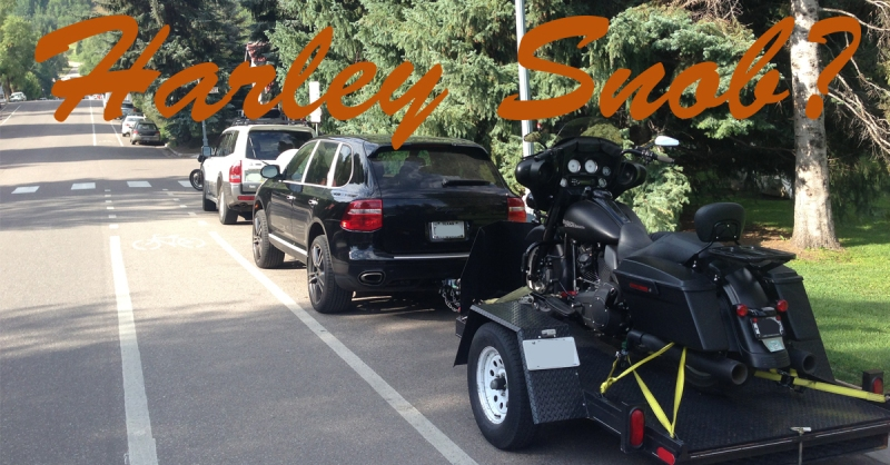 A guy towing his bagger by means of Porsche in Aspen, CO on a beautiful sunny day.